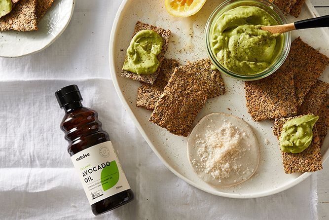 AVOCADO, LIME AND TAHINI DIP WITH FLAX CRACKERS